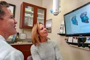 Dr. Jelic speaking with a patient